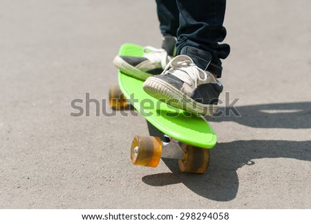 Skateboarder riding a skateboard.