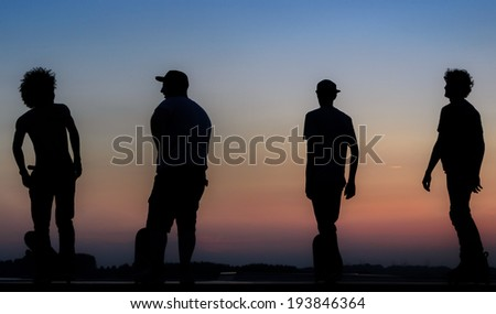 skateboarder silhouette on top of a massive ramp  - stock photo