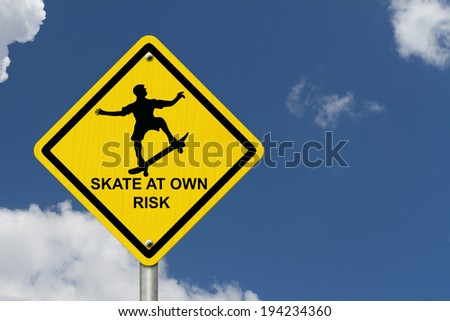 Skateboarding Warning Sign, An yellow caution road sign with skateboarder icon and text skate at own risk with blue sky background - stock photo