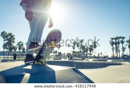 Skater boy ready to performing tricks at the skate park - stock photo