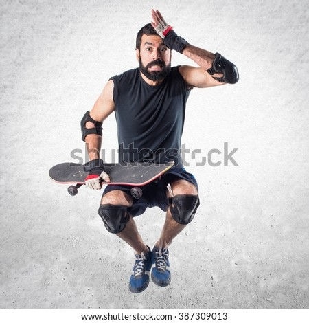 Skater jumping and doing surprise gesture