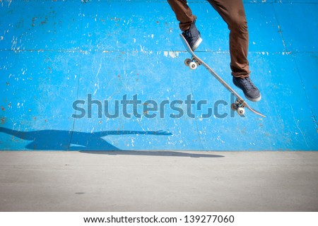 Skater jumps high in air under extrem-park - stock photo