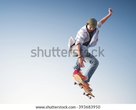 Skater on the sky background. Sport and active life concept - stock photo