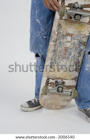 skater shoes, board & ripped jeans