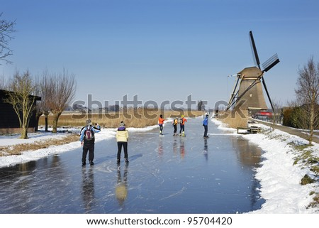 Skating on the river near the village of Goudriaan in winter, Holland - stock photo