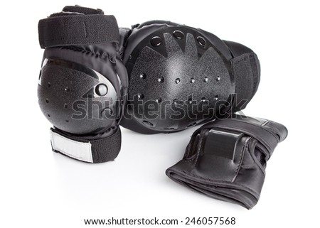 skating protection equipment, knee and wrist protectors, on a white background - stock photo