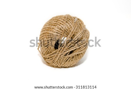 Skein of hard brown twine on a white background - stock photo
