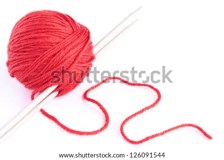 Skein of wool and knitting needles on white background.