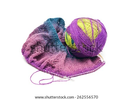 Skein of wool yarn and knitted items isolated on white background - stock photo