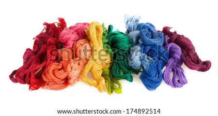 skeins of multicolored threads for embroidery - muline. on a white background