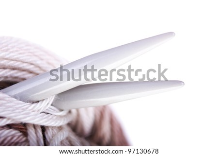 Skeins of yarn, needles closeup on the white background. With sample text. - stock photo