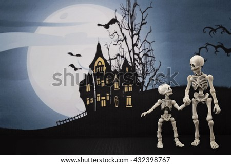 Skeleton and little skeleton with Halloween background
