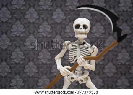 skeleton and scythe - stock photo