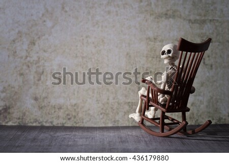 Skeleton and the rocking chair - stock photo