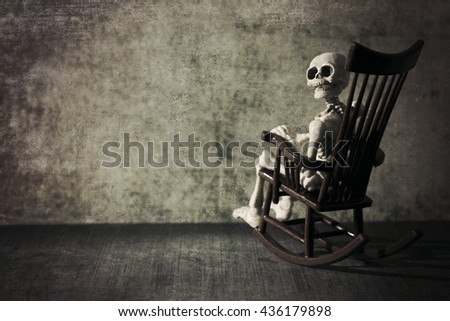 Skeleton and the rocking chair grungy textured