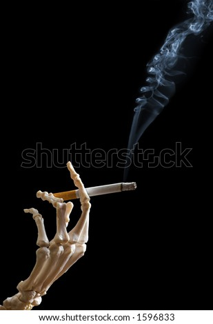 Skeleton hand holding a cigarette - stock photo