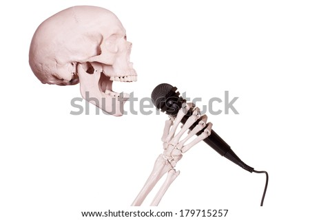 skeleton hand holding microphone