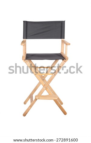 Skeleton in clothes next to the chair filmmaker - stock photo