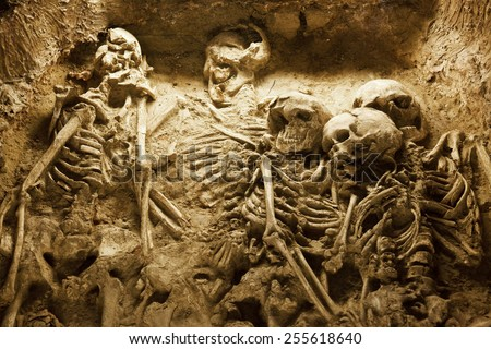 Skeleton of a family in an ancient sacrifice pit in China - stock photo