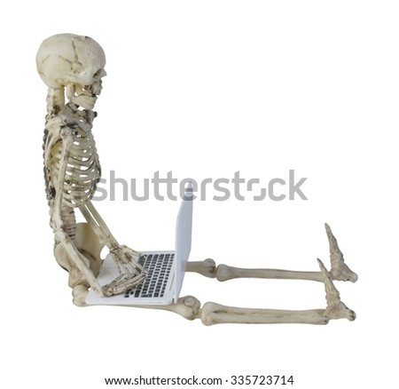 Skeleton using a Laptop computer used for data management, storage and convenience - path included - stock photo