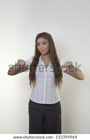 Skeptical business woman  thumbs in the middle - stock photo