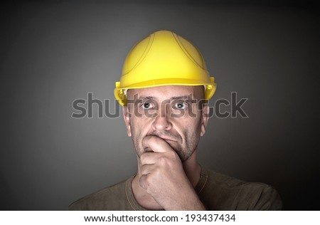 Skeptical or thoughtful worker