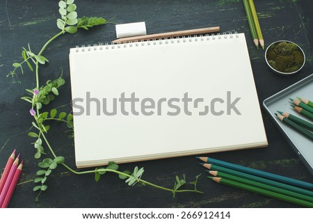 sketch book, moss and color pencils in green tones, mock up - stock photo