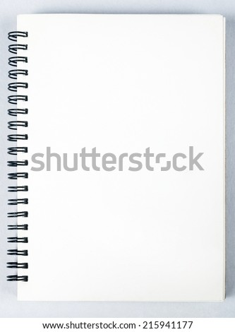 sketch book with pencil on white background