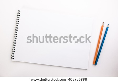 sketch pad and colored pencils - stock photo