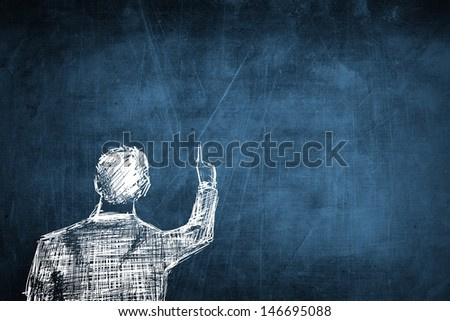 Sketch successful businessman pointing something on empty blue chalkboard - stock photo