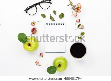 sketchbook with cup coffee, green apples with leaves, dry rose flowers and glasses. Flat lay, top view - stock photo