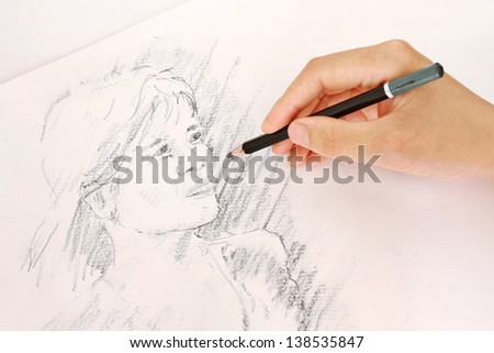 Sketching a Woman's Face with a Pencil