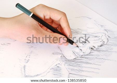 Sketching a Woman's Face with a Pencil - stock photo