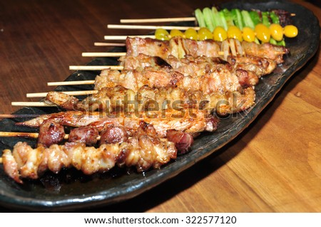 Skewer meat Japanese style on dish - stock photo
