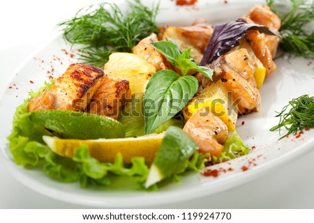 Skewered Salmon with Lemon, Herbs and Vegetables - stock photo