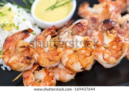 Skewered Tiger Prawns with a portion of fresh Rice - stock photo