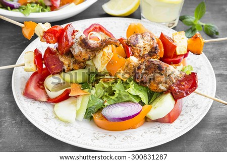 Skewers Meal with Grilled Chicken, Tomatoes, Peppers, Pumpkins and Vegetable Salads
