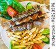 skewers mix arabic kebabs in Jordanian street restaurant - stock photo