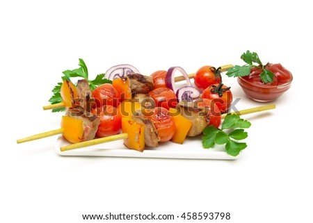 skewers of meat with vegetables on a white background. horizontal photo. - stock photo