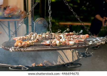 skewers on the grill over the big pot - stock photo
