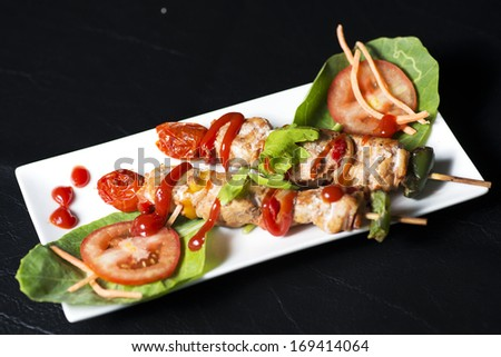 Skewers with vegetables and meat - stock photo