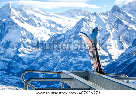 ski at the front on the background of the Alps