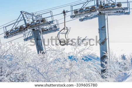 Ski chair lift is covered by snow in winter, Korea. - stock photo