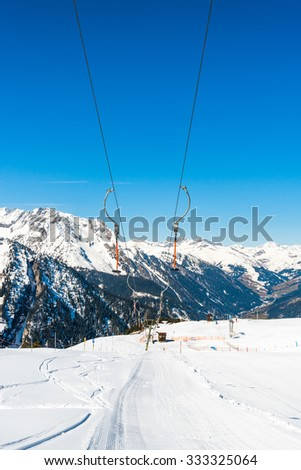 Ski drag lift in Alpine ski resort in the winter, Austria