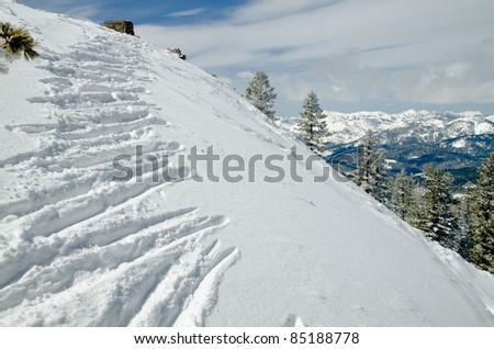 Ski footprints on the snow - stock photo