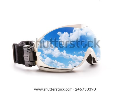 Ski glasses with sky reflection