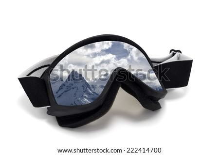 Ski goggles with reflection of snow mountains. Isolated on white background - stock photo