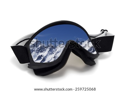 Ski goggles with reflection of snowy mountains at wind day. Isolated on white background - stock photo
