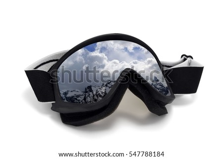 Ski goggles with reflection of winter snow mountains. Isolated on white background