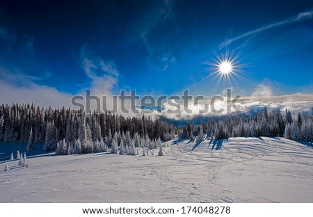 Ski hill on a sunny day. - stock photo